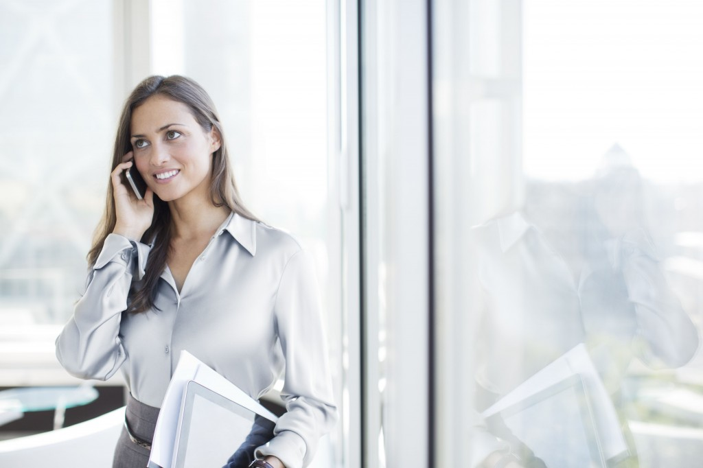 businesswoman-talking-on-cell-phone-in-office-164852508-58dac7b23df78c5162dcdb25.jpg